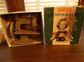 Mini vintage singer sewing machine.
