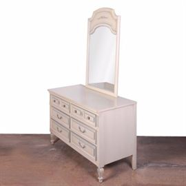 "French Provincial Style Dresser by Gardner: A French Provincial style dresser with mirror by Gardener. This white dresser features a set of six half width drawers with blue trim that rise above tapered legs terminating on arrow feet. The reverse of the dresser is marked ""Gardner."""