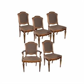 Set of Federal Style Upholstered Dining Chairs: A set of Federal style mahogany upholstered dining chairs. The set includes one armchair and four sides. The chairs feature a mahogany frame and are upholstered in purple silk and trimmed in pink gimp. The chairs rise on front fluted legs ending with arrow feet and curved back legs. The legs and aprons are embellished with carved details and painted gold. The armchair has gold painted acanthus leaves accenting the arm supports. Unmarked.