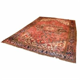 Hand-Knotted Persian Heriz Wool Area Rug: A hand-knotted Persian Heriz wool area rug. This rug is rendered in a palette of crimson, black, ivory, indigo, ochre, and sky blue. Beginning the abrashed lozenged field is a large star medallion, and filled with lancette leaf, ashik, floral, bird, and geometric motifs, along with hooked sawtooth bordered spandrels. Framing the field is a main samovar border and chained florette guard borders. Finishing the rug are double overcast selvedges and a short natural warp ivory fringe to the ends. Unlabeled.