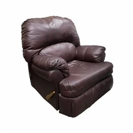 Maroon Leatherette Recliner: A recliner upholstered in maroon leatherette fabric. This piece features a cushioned back, arms, and seat. It has a wooden manual lever to one side which allows the footrest to extend.