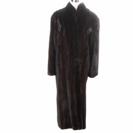 "Chocolate Mink Fur Coat: A chocolate mink fur coat. This coat has a shawl style collar and verticle pelts. It has a brown satin style lining with a black ""The Fur Source"" label."