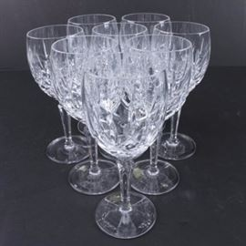 "Gorham ""Lady Anne"" Crystal Glasses: A set of Gorham Lady Anne crystal wine glasses. This eight piece set of wine glasses from Gorham are presented in the Lady Anne pattern with vertical and criss cross cuts to the bowl, facet stem and round base. The base is marked to the underside ""Gorham."""