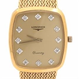 Longines Diamond Face Wristwatch: A Longines diamond face, gold-tone dress watch. This timepiece features a brushed gold-tone dial with single cut diamonds in place of numeral hour markers, mirror finish gold-tone hands, and a gold-tone basket weave link band.