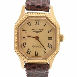 Longines Octagonal Quartz Wristwatch: A vintage Longines wristwatch. This timepiece features an octagonal case with dot banding, a gold tone face with Roman numerals and a brown lizard band.