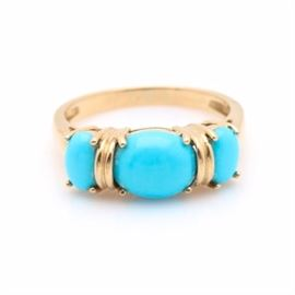 14K Yellow Gold Turquoise Ring: A 14K yellow gold turquoise ring. This ring features three oval cabochon turquoise, which are separated by a ridged gold band between each stone.