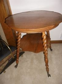 Parlor table with glass claw feet.