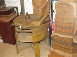 An old wooden washing machine. Needs to be restored.