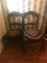 (2) arch back (with fruit carving) dining chairs $75 each