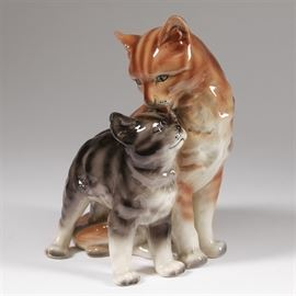 "Vintage Erphila Porcelain Cat Figurine: A vintage Erphila porcelain cat figurine. Featured is the porcelain form of an orange mother cat grooming her happy gray striped kitten. The underside is stamped ""Erphila, Germany"" in emerald ink."