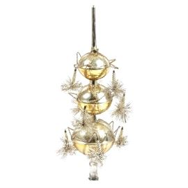 "Vintage Christmas Tree Topper: A gold tone Christmas tree topper. This vintage piece features three glass orbs with a gold tone finish and matching embellishments made of plastic. The piece is labeled ""Made in Western Germany""."