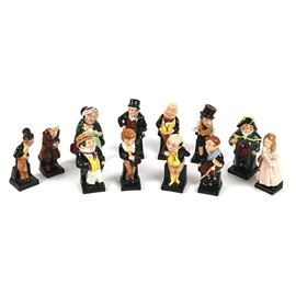 Royal Doulton Character Figurine Collection: A collection of twelve Royal Doulton character figurines. The figurines are all made of porcelain and are hand-painted. The characters include Sairey Gamp, Bill Sikes, Bumble, Little Nell, Captain Cuttle, David Copperfield, Dick Swiveller, Scrooge, Sam Weller, Micawber, Pickwick, and Tiny Tim.
