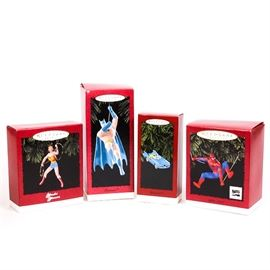 """Hallmark Keepsake """"Superhero"""" Christmas Ornaments: A group of four Hallmark Keepsake 1990s Christmas ornaments. The ornaments all depict famous comic book characters, including Spider-Man, Wonder Woman and Batman. The """"Wonder Woman"""" ornament was sculpted by Anita Marra Rogers. All are made of hand-painted resin material, and all of the boxes and ornaments are marked with Hallmark and the name of the character. The """"Spider-man"""" box is also marked on the front with the Marvel Comics logo."""