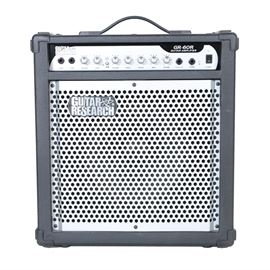 "Guitar Research Amplifier: A Guitar Research guitar amplifier, model GR-60R, with a grated grille; serial number is 05061551. The amplifier's speaker is labeled ""Megatone Equipped"" by Partsland Megatone Amplifier. Please note that no power cable is included."