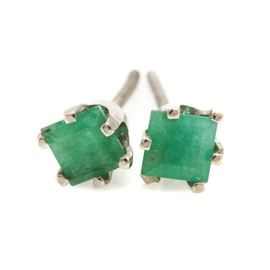 14K White Gold Emerald Earrings: A pair of 14K white gold screw back earrings displaying two emeralds.