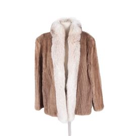 Mink and Fox Fur Coat: A mink and fox fur coat. This collarless coat is constructed from pinstriped mink and leather with fox fur trim to the neckline and placket. The interior is lined in a taupe satin and is unmarked.