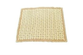 Handwoven Portuguese Arraiolos Area Rug: A handwoven Portuguese Arraiolos area rug. This wool rug is hand-stitched in a palette of cream, saffron, celadon, teal, tomato, cerulean, and shades of green. It features a diamond- lattice pattern grounded in cream, each panel enclosing a tulip with a saffron bloom. Framing the field are compound borders, including a primary border featuring a concentric diamond pattern over cream. The rug finishes on all sides with looped fringe in cream. It is unlabeled.
