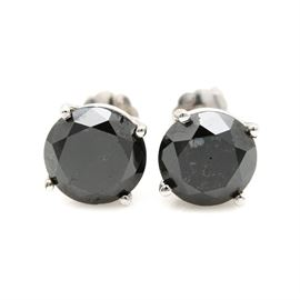 14K White Gold 3.43 CTW Black Diamond Earrings: A pair of 14K white gold screw back earrings showcasing two black diamonds. The total carat weight of all diamonds included is 3.43 ctw.
