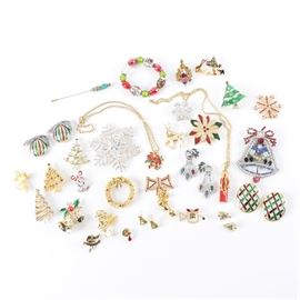 Vintage Christmas-Themed Costume Jewelry Featuring Eisenberg Ice: An assortment of vintage silver and gold tone metal Christmas-themed costume jewelry including one stick pin, one necklace, one bracelet, two pins, four pairs of earrings, and twenty-one brooches. The items feature traditional holiday themes of bells, ornaments, wreaths, poinsettias, Christmas trees, reindeer, and angels in red, green, and gold hues. Materials include foilbacks, enamel, and glass. Maker's marks include Art, Eisenberg Ice, AAI, USA, SFJ, and other illegible marks.