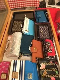 Coach wallets still in boxes