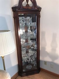 Beautiful mahogany  curio cabinet filled with quality crystal items