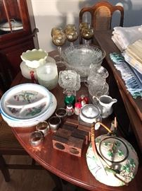 Wine goblets; flatware; crystal; teapot; napkin holders; matching cream and sugar, etc.