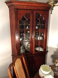 Beautiful curio cabinet filled with antiques and collectibles