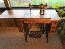 Vintage Singer sewing machine and cabinet like-new