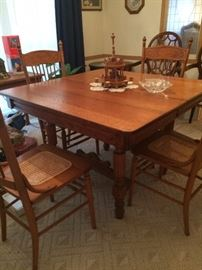 Antique Oak Table w/One Leaf (not shown), and four caned chairs