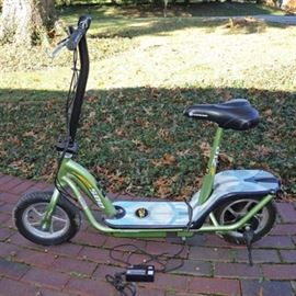 eZip Electric Scooter 500: An eZip Electric Scooter 500 24 volt electric scooter, serial number ACA08H008226; features include a lime green frame, brakes at handlebar, a Currie Technologies Exclusive Currie Electro Drive system, 500 watts of performance power, and two AGM lead acid batteries. A rechargeable plug is included.