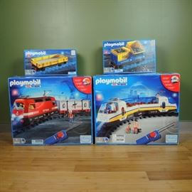 Playmobile RC Train Set: A Playmobile RC train set. This listing includes boxed sets for the Playmobile RC train system. Sets include model numbers 4010, 4011, 4125, and 4126; all are stored in the original boxes.
