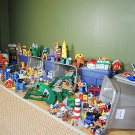Massive Fisher Price GeoTrax Collection: A massive Fisher Price GeoTrax collection. This listing includes seven bins full of GeoTrax road and rail system sets. Hundreds of pieces are included from a variety of sets. The lidded storage bins are included. These items are located on the upper level of the home.