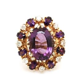 14K Yellow Gold Amethyst and Diamond Statement Ring: A 14K yellow gold amethyst and diamond statement ring. This 0.72 ctw ring features a center amethyst gemstone, the ring is embellished with amethyst and diamond stones above a wide pierced gallery.