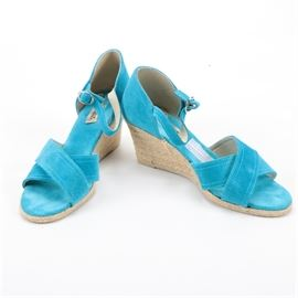 Pare Cabia Espadrille Wedges: A pair of Pare Cabia espadrille wedges. The shoes feature crossed toe straps in aqua colored suede, and a buckled ankle strap on a closed counter. The wedge heels are covered with rows of esparto rope.