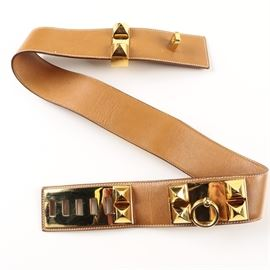 "Hermès Collier de Chien Leather Belt: A collier de chien belt by Hermès. This piece boasts hand-stitched camel colored leather with gold tone hardware. It is finished with a post closure, pyramid studs, and a pull ring. The hardware bears an impressed mark to the verso which reads ""Hermès."