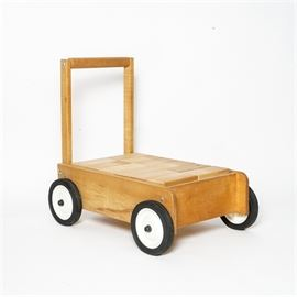 Wood Children's Building Blocks Cart: A wood children's building block cart. The cart features several equally sized rectangular wood building blocks held in a four-wheeled storage cart. The cart and blocks do not feature a manufacturer's mark.