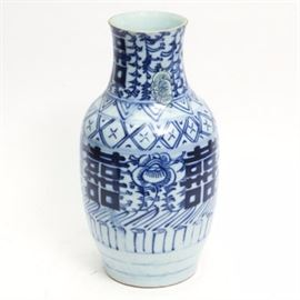 Antique Chinese Porcelain Vase: An antique Chinese porcelain vase. This piece boasts a rouleau style shape decorated with a gloss white glaze and myriad bands of cobalt geometric motifs. The body is further accented with alternating flowers and a 'double happiness' symbol. The piece has been restored in two places along the shoulder. It bears no discernible maker's marks.
