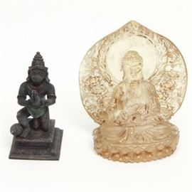 Hindu and Buddhist Figurines: A selection Hindu and Buddhist figurines. The pair features a bronze tone figurine depicting a praying monkey known as Hanuman Pay Rama, a Hindu god. Also included is a molded plastic wall plaque figurine of Buddha. The cream tone plaque with gold tone highlights.Both are unmarked.