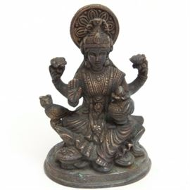 Vintage Brass Hindu Goddess Lakshmi Statuette: A vintage brass statuette of the Hindu goddess Lakshmi. This unmarked statuette depicts the Hindu goddess Lakshmi, the goddess of wealth, fortune, and prosperity. She is depicted seated on a lotus blossom with an owl perched on her leg. The piece is not marked.