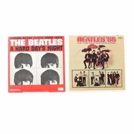 "Two Vintage Beatles LPs"": A pair of vintage Beatles records. Included is Beatles '65 and A Hard Day's Night. Records were released by Capital and United Artists respectively."