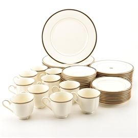 "Lenox ""Urban Lights"" Tableware: A set of Lenox Urban Lights tableware. This set of tableware from Lenox is presented from the American Home Collection in the Urban Lights pattern with a gold rim, black verge and inner gold band. Included in this set is ten dinner platers, ten salad plates, ten bread and butter plates, ten teacups and ten saucers. The base is marked to the underside ""American Home Collection Lenox Urban Lights Lenox Fine China Made in USA."""