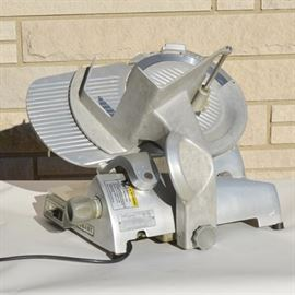 Hobart Edge Commercial Electric Meat Slicer: A Hobart Corporation Edge electric meat slicer. Model #ML 134054. This commercial food preparing machine is 120 volt, with 1650 RPMS and 1/3 HP.