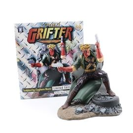 Jim Lee's Grifter Limited Edition Sculpture: A limited edition sculpture from Moore Creations. This piece is hand painted and is in the form of the Aegis character The Grifter. The maker's and edition marks are present on the underside of the piece which marks it as number 985 of 2,200 produced.