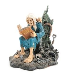 Limited Edition Crypt Keeper Hand Painted Statue: A limited edition statue from Graphitti Designs. This piece is composed of painted plastic and is in the form of the Crypt Keeper reading from the Tales of the Crypt. The maker's and edition marks are present on the underside of the piece which marks it as number 783 of 2,500 produced.