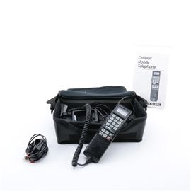 Vintage Nynex Car Phone with Case: A vintage Nynex car phone with case. This vintage car phone, model SCN400A, features a cradle with touch button handset and comes with zippered case, car power adapter, external speaker and user manual.