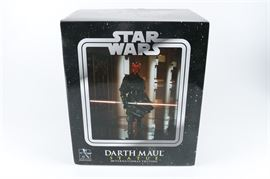 Darth Maul Early Run Limited Edition Statue: A limited edition statue from Gentle Giant Studios. This piece is composed of resin and is in the form of the character Darth Maul based on his appearance in the 1999 film Star Wars Episode I: The Phantom Menace. The maker's and edition marks are present on the underside of the base which marks this piece as number 70 of 2,000 produced.