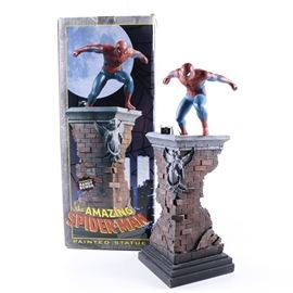 "Marvel Comics Spider-Man Limited Edition Figurine by Bowen Designs: A limited edition and numbered Spider-Man figurine by Bowen Designs. Features a stunning figure of Peter Parker, the Amazing Spider-Man, from Marvel Comics, springing into action from atop a rooftop. The underside is labelled ""The Amazing Spider-Man, TM & © 2001 Marvel Characters, Inc… Sculpted by Randy Bowen, Produced by Bowen Designs, Inc., Made in China,"" and is numbered 1381 of 5000. The figure comes in its original box."
