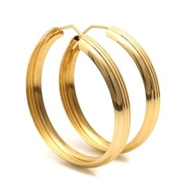 18K Yellow Gold Fluted Hoop Earrings: A pair of 18K yellow gold hoop earrings with fluted accents.