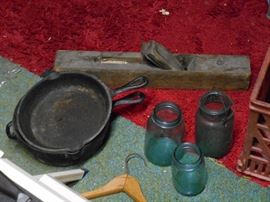 Cast Iron Frying Pans, Blue Jars, Plane