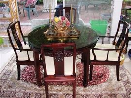 Asian motif table with custom glass top.  Comes with 6 chairs and leaf extenders.